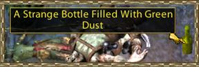 Strange bottle filled with green dust.